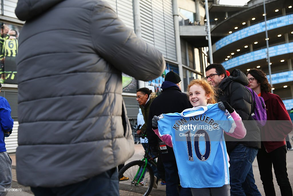 A young fan holds the shirt of Sergio Aguero of Manchester City prior to the Barclays Premier League match between Manchester City and Tottenham Hotspur at Etihad Stadium on February 14, 2016 in Manchester, England.