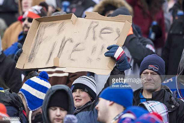 A young fan holds up a pizza box with the words 'Fire Rex' written on it during the first half of the game between the Buffalo Bills and the...