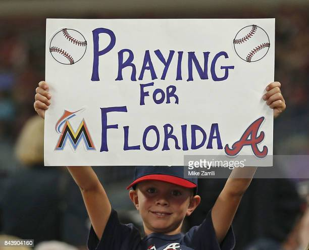 A young fan holds up a sign during the game between the Miami Marlins and the Atlanta Braves at SunTrust Park on September 7 2017 in Atlanta Georgia