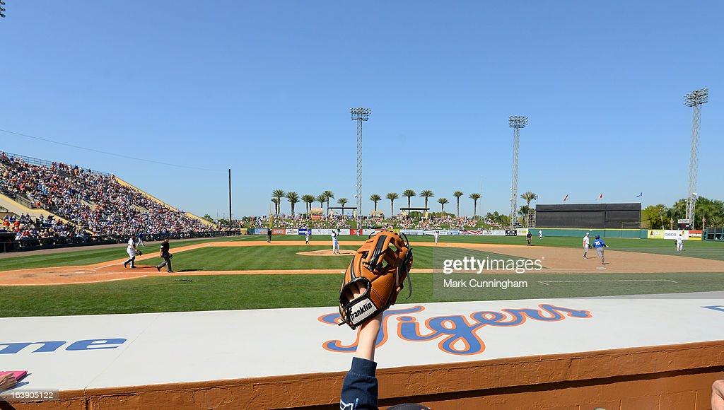 A young fan holds up their baseball glove during the spring training game between the Detroit Tigers and the Toronto Blue Jays at Joker Marchant Stadium on March 15, 2013 in Lakeland, Florida. The Tigers defeated the Blue Jays 4-2.