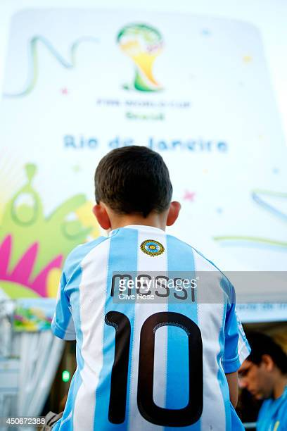 A young fan in a Lionel Messi of Argentina jersey looks on prior to the 2014 FIFA World Cup Brazil Group F match between Argentina and...