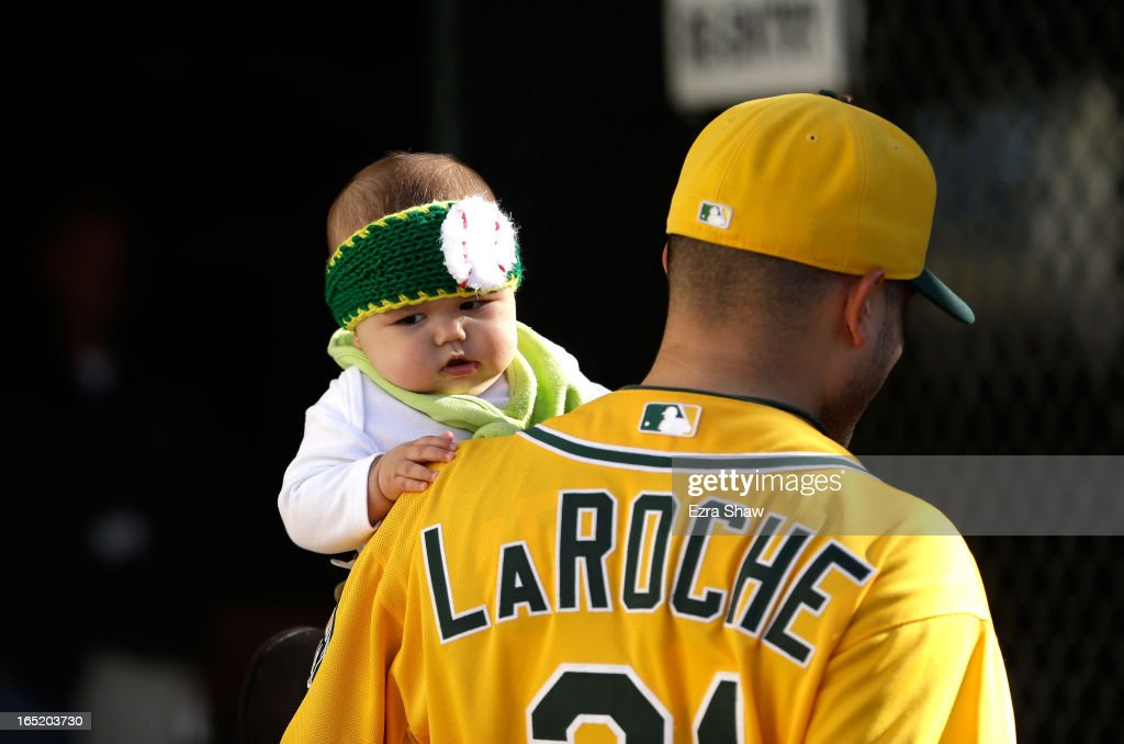 A young fan is carried to the stadium for the Oakland Athletics game against the Seattle Mariners on Opening Day at O.co Coliseum on April 1, 2013 in Oakland, California.