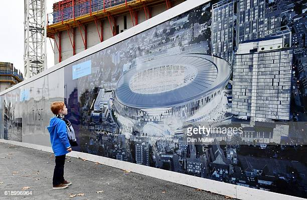 A young fan looks at the plans for the new Tottenham Hotspur stadium prior to kick off during the Premier League match between Tottenham Hotspur and...