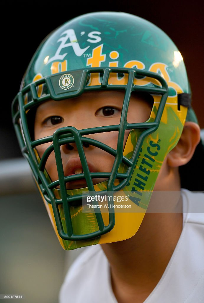A young fan looks on while seeking autographs prior to the start of the game between the Seattle Mariners and Oakland Athletics at the Oakland Coliseum on August 12, 2016 in Oakland, California.