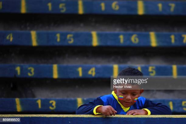 A young fan of Ecuador gestures prior a match between Ecuador and Argentina as part of FIFA 2018 World Cup Qualifiers at Olimpico Atahualpa Stadium...