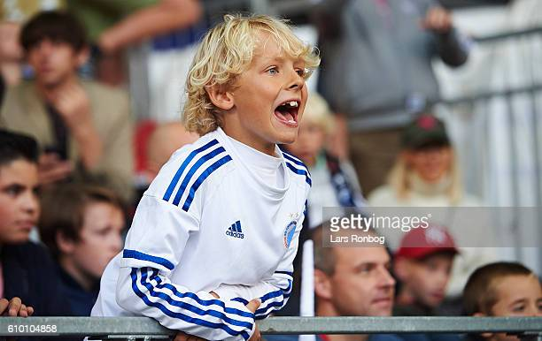 Young fan of FC Copenhagen cheer during the Danish Alka Superliga match between FC Copenhagen and AGF Aarhus at Telia Parken Stadium on September 24...