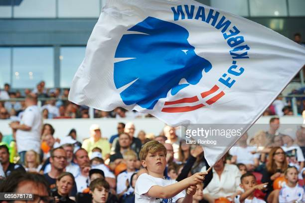 A young fan of FC Copenhagen cheer with a flag prior to the Danish Alka Superliga match between FC Copenhagen and Sonderjyske at Telia Parken Stadium...