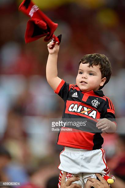 Young fan of Flamengo celebrates a victory against Coritiba during a match between Flamengo and Coritiba as part of Brasileirao Series A 2014 at...