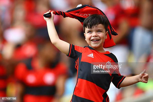 Young fan of Flamengo vibrates before a match between Flamengo and Corinthians as part of Brasileirao Series A 2016 at Maracana stadium on October 23...