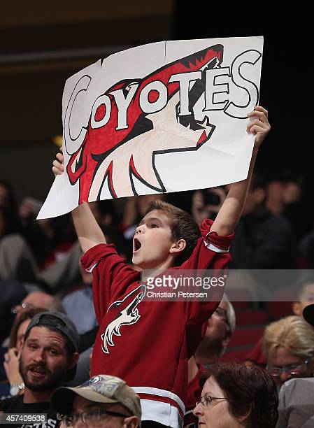A young fan of the Arizona Coyotes holds up a sign during the NHL game against the Edmonton Oilers at Gila River Arena on October 15 2014 in Glendale...