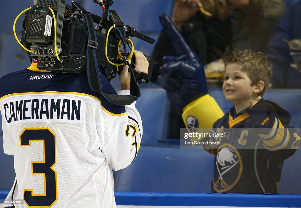 A young fan of the Buffalo Sabres displays his support for the camera man during the pre-game skate before their NHL game against the Toronto Maple Leafs at First Niagara Center on January 29, 2013 in Buffalo, New York.