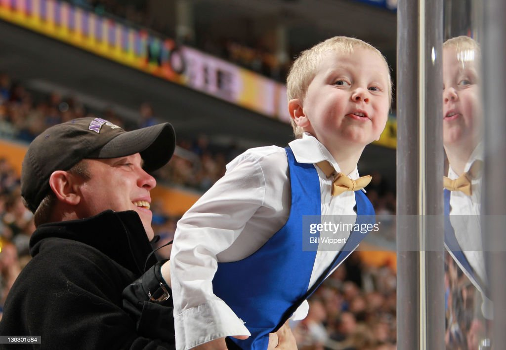 A young fan of the Buffalo Sabres, dressed for New Year's Eve, tries to get a look at the action in a game against the Ottawa Senators at First Niagara Center on December 31, 2011 in Buffalo, New York.