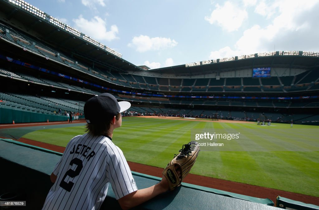A young fan of the New York Yankees watches batting practice out on the field before the start of the game against the Houston Astros at Minute Maid Park on April 1, 2014 in Houston, Texas.