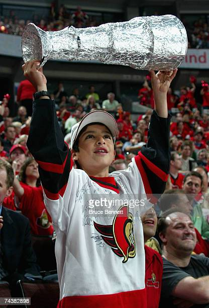 A young fan of the Ottawa Senators cheers on his team against the Anaheim Ducks during Game Three of the 2007 Stanley Cup finals on June 2 2007 at...
