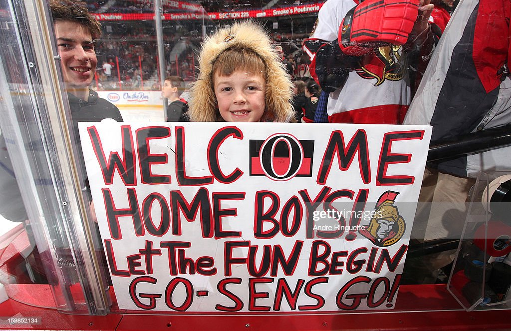 A young fan of the Ottawa Senators welcomes back his team before a game against the Florida Panthers on January 21, 2013 at Scotiabank Place in Ottawa, Ontario, Canada.