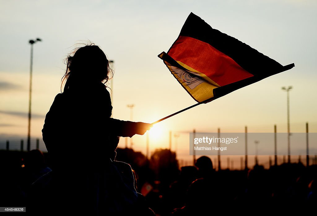 A young fan outside the stadium waves with a flag prior to the international friendly match between Germany and Argentina at Esprit-Arena on September 3, 2014 in Duesseldorf, Germany.