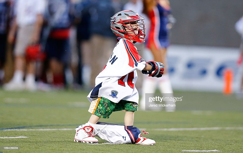 A young fan participates in a halftime game during the MLL game between the Boston Cannons and the Chesapeake Bayhawks on May 18, 2013 at Harvard Stadium in Boston, Massachusetts.