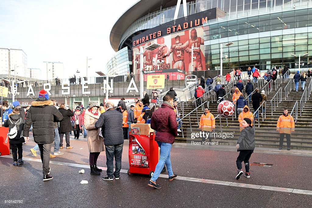 A young fan plays football as fans arrive at the stadium before the Barclays Premier League match between Arsenal and Leicester City at Emirates Stadium on February 14, 2016 in London, England.