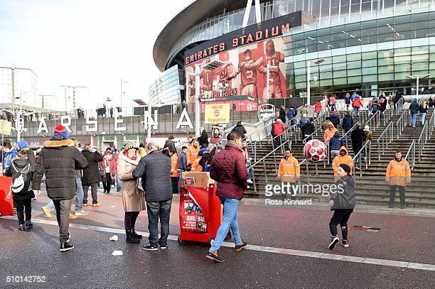A young fan plays football as fans arrive at the stadium before the Barclays Premier League match between Arsenal and Leicester City at Emirates...