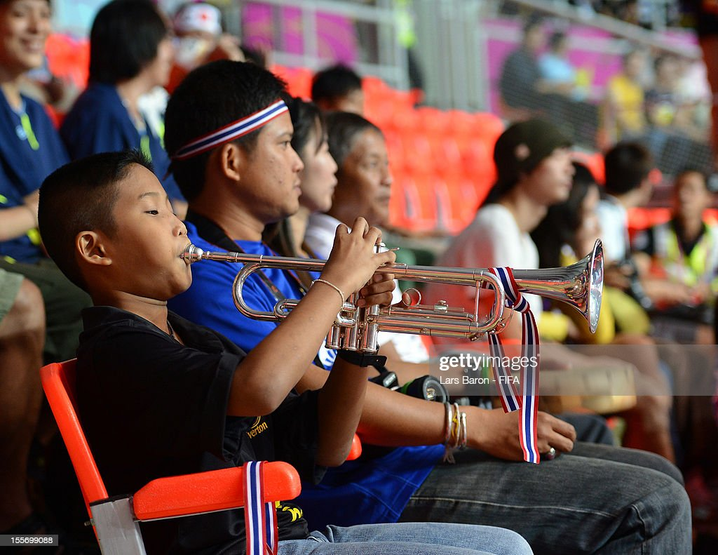 A young fan plays the trumpet during the FIFA Futsal World Cup Group C match between Japan and Libya at Indoor Stadium Huamark on November 7, 2012 in Bangkok, Thailand.
