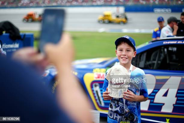 A young fan poses for a photo before the Monster Energy NASCAR Cup Series Alabama 500 at Talladega Superspeedway on October 15 2017 in Talladega...