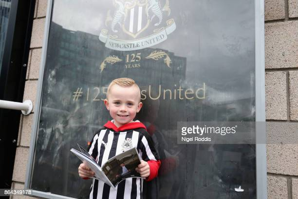 A young fan poses for a photo during the Premier League match between Newcastle United and Crystal Palace at St James Park on October 21 2017 in...