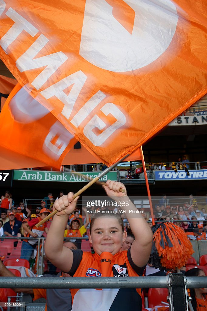 A young fan poses for a photo prior to the round six AFL match between the Greater Western Sydney Giants and the Hawthorn Hawks at Spotless Stadium on April 30, 2016 in Sydney, Australia.