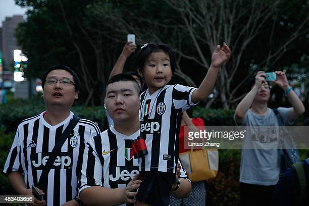 A young fan reacts to Juventus before during the Italian Super Cup final football match between Juventus and Lazio at Shanghai Stadium on August 8...