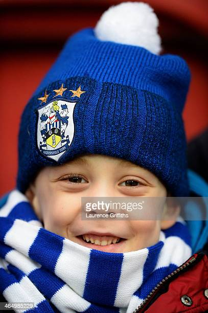 A young fan reads is all smiles prior to the Budweiser FA Cup Fourth Round match between Huddersfield Town and Charlton Athletic at John Smith's...