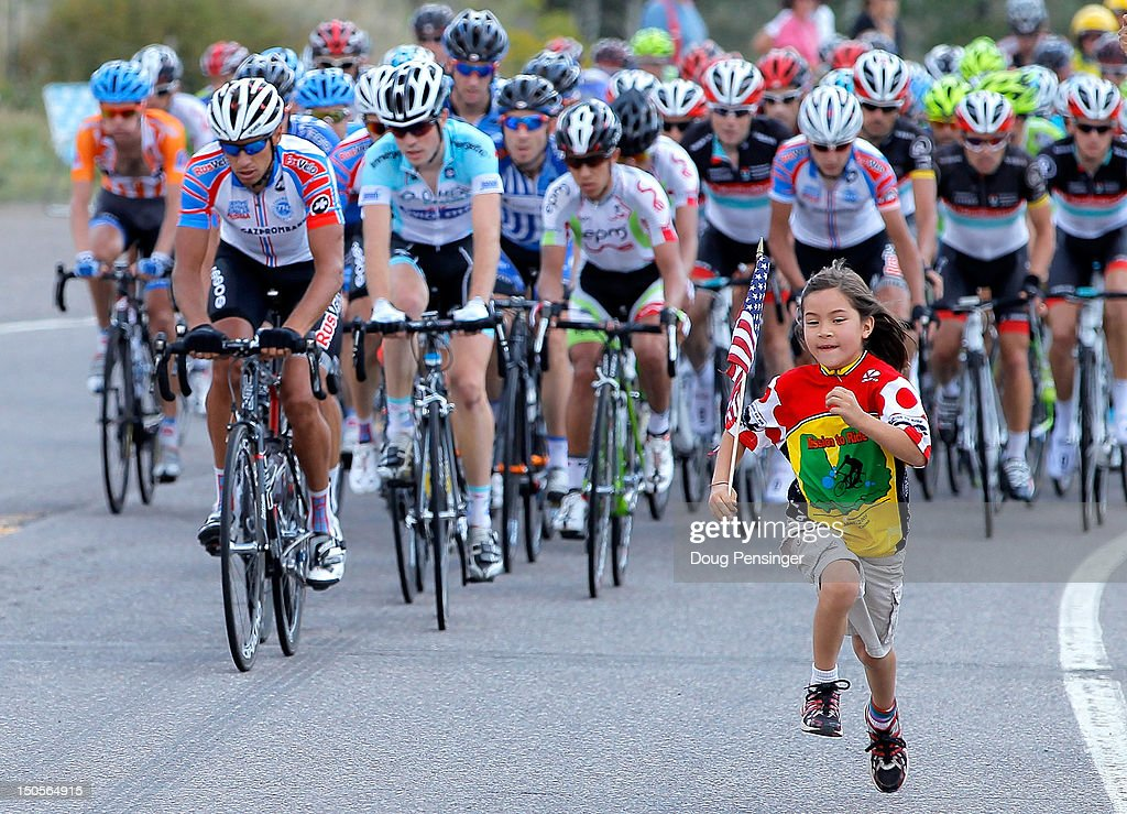 A young fan runs in front of the peloton during stage two of the USA Pro Challenge from Montrose to Crested Butte on August 21, 2012 in Sapinero, Colorado.