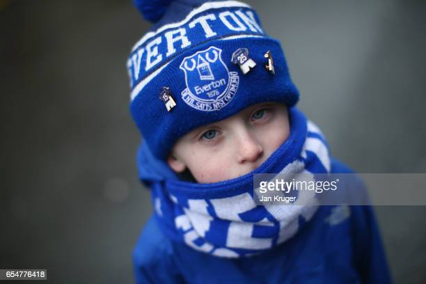 A young fan shows his allegiance prior to the Premier League match between Everton and Hull City at Goodison Park on March 18 2017 in Liverpool...