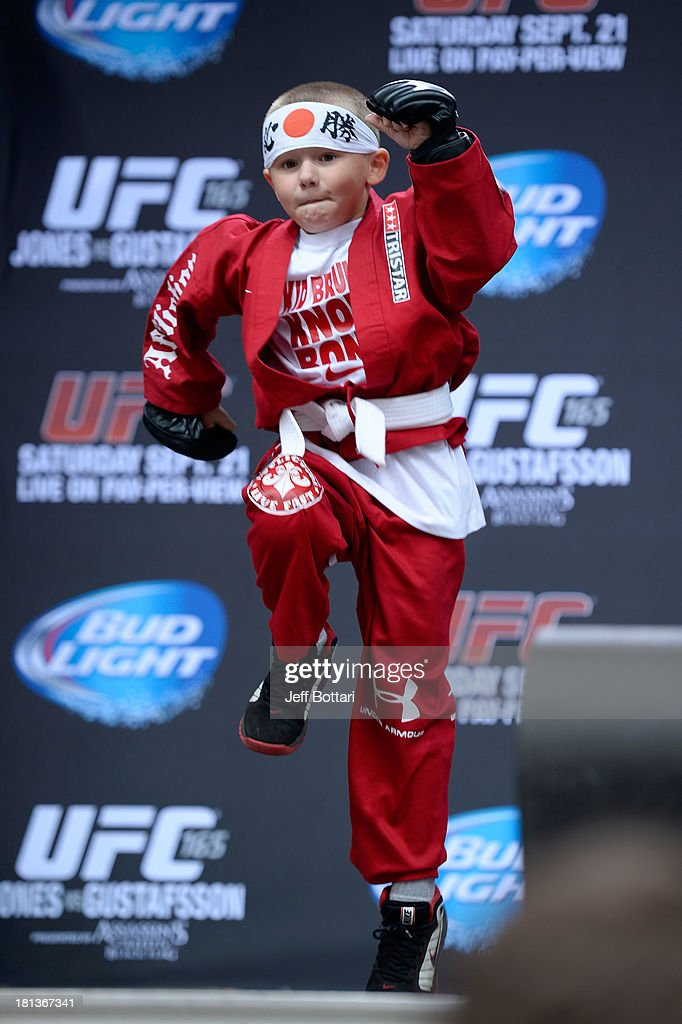 A young fan shows his mms skills to the crowd during a Q&A session before the UFC 165 weigh-in at the Maple Leaf Square on September 20, 2013 in Toronto, Ontario, Canada.