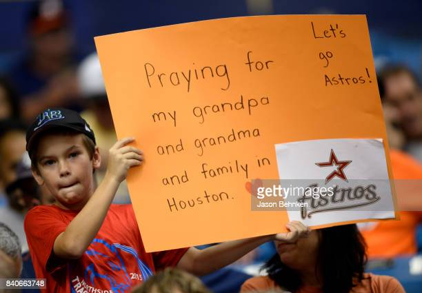A young fan shows his support for family in Houston during the Texas Rangers versus Houston Astros game at Tropicana Field on August 29 2017 in St...