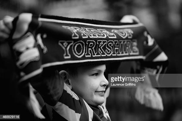 A young fan shows his support prior to the FA Cup Quarter Final betweeen Braford City and Reading at Coral Windows Stadium Valley Parade on March 7...