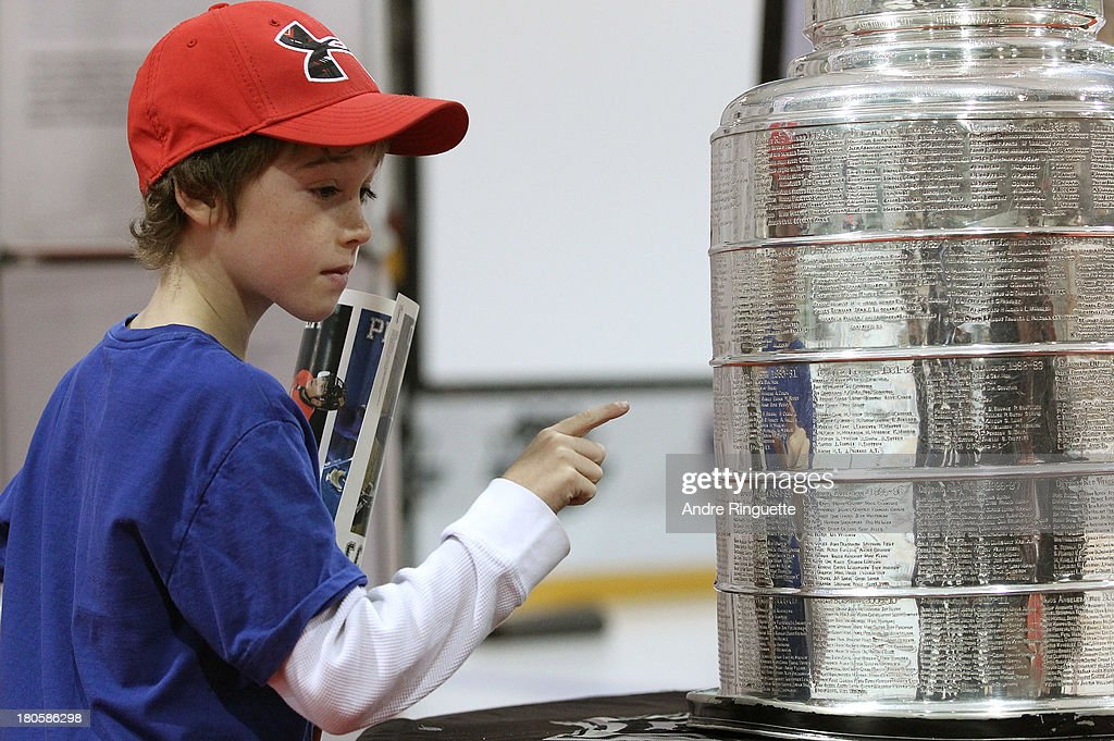 A young fan takes a close look at the Stanley Cup at the Stirling and District Recreation Centre during Kraft Hockeyville Day 2 on September 14, 2013 in Stirling, Ontario, Canada.