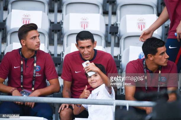 A young fan takes a selfi with Angel Di Maria of PSG during the Champions Trophy match between Monaco and Paris Saint Germain at Stade IbnBatouta on...