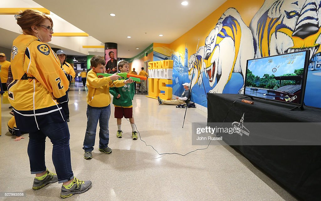 A young fan takes aim in a game of Duck Hunt prior to Game Four of the Western Conference First Round between the Nashville Predators and the Anaheim Ducks during the 2016 NHL Stanley Cup Playoffs at Bridgestone Arena on April 21, 2016 in Nashville, Tennessee.