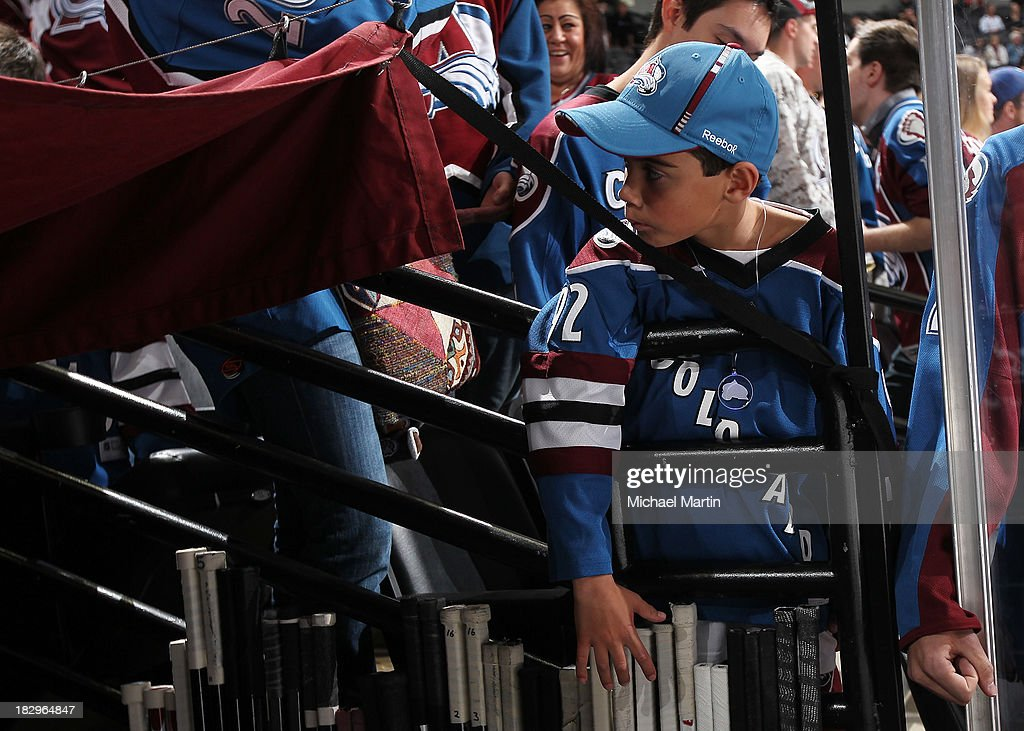 A young fan waits for the Colorado Avalanche to take the ice against the Anaheim Ducks on opening night at the Pepsi Center on October 2, 2013 in Denver, Colorado.