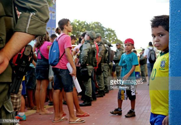 A young fan waits outside the Estadio Presidente Vargas stadium during a Brazil training Session ahead of their Confederations Cup 2013 match against...