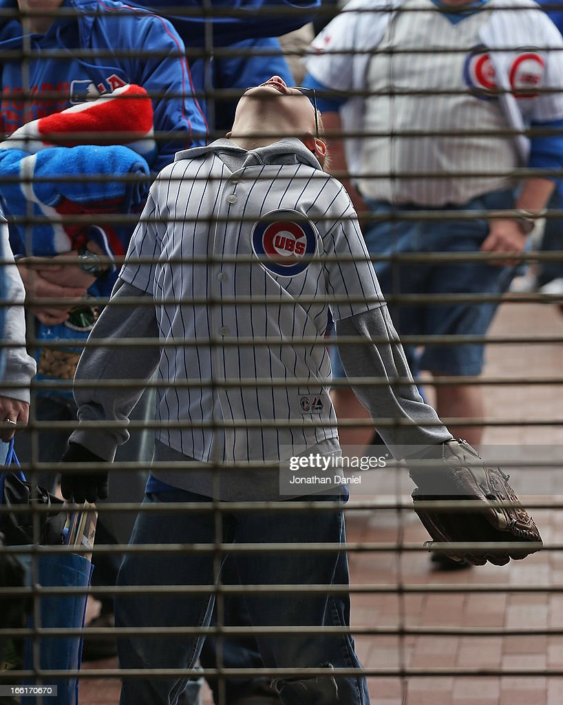 A young fan waits to enter Wrigley Fielod before the Opening Day game between the Chicago Cubs and the Milwaukee Brewers at Wrigley Field on April 8, 2013 in Chicago, Illinois. The Brewers defeated the Cubs 7-4.