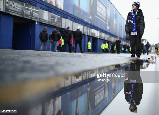 A young fan walks outside the stadium prior to the Premier League match between Everton and Hull City at Goodison Park on March 18 2017 in Liverpool...