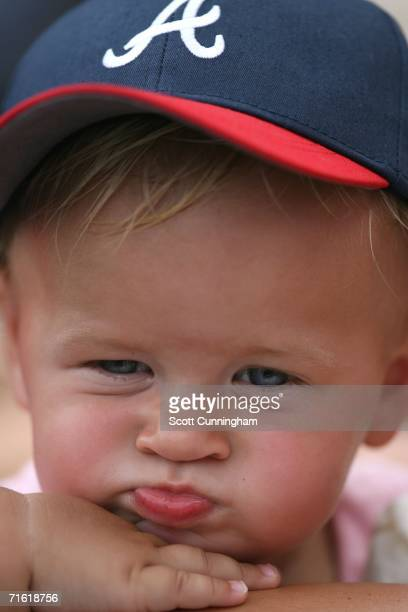 A young fan watches the action between the Atlanta Braves and the Philadelphia Phillies on August 9 2006 at Turner Field in Atlanta Georgia The...