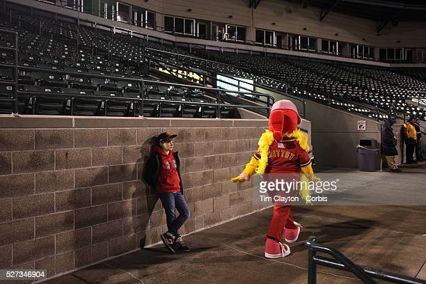 A young fan watches the ball game as Mittsy the mascot walks past during the Rochester Red Wings V The Scranton/WilkesBarre RailRiders Minor League...