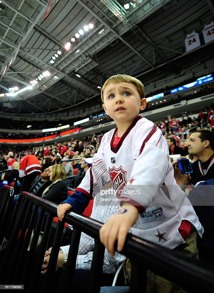 A young fan watches the game between the Toronto Maple Leafs and the Carolina Hurricanes during play at PNC Arena on February 14, 2013 in Raleigh, North Carolina. Carolina defeated Toronto 3-1.