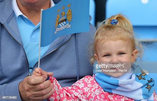 A young fan waves her flag prior to the Women's Super League match between Manchester City and Sunderland at the Manchester City Academy Stadium on...