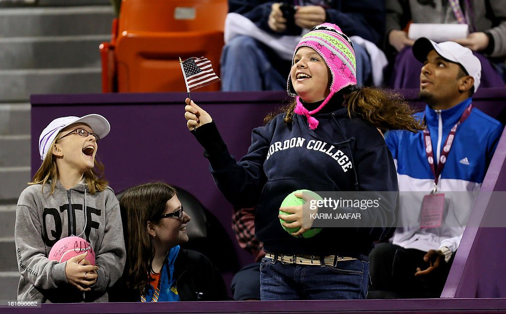 A young fan waves the American flag during the tennis match between Poland's Urszula Radwanska and Serena Williams of the US in WTA Qatar Open on February 14, 2013 in the Qatari capital Doha. Williams won the match 6-0, 6-3.
