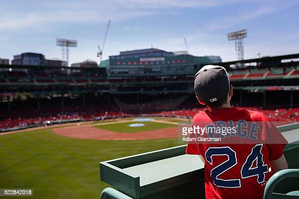 A young fan wearing a David Price shirt sits in the Green Monster seats before the Boston Red Sox take on the Tampa Bay Rays at Fenway Park on April...