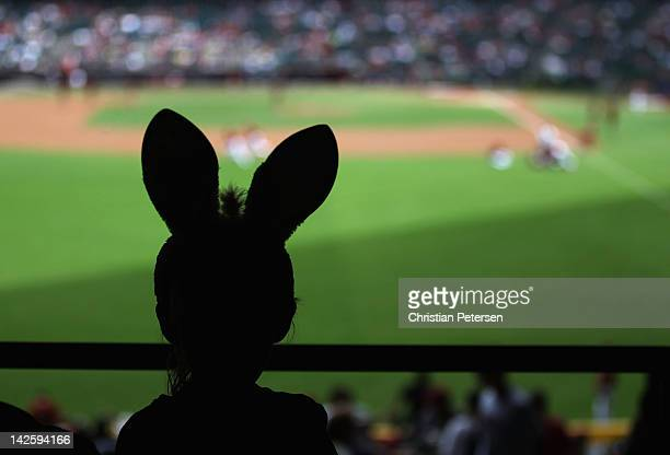 A young fan wearing bunny ears in honor of Easter attends the MLB game between the San Francisco Giants and the Arizona Diamondbacks at Chase Field...
