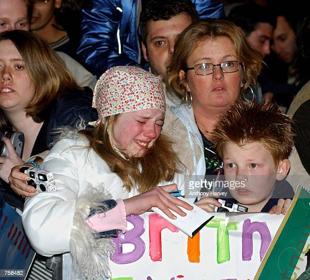 A young fan weeps after waiting all day day for a sight of Britney Spears and not seeing her idol at the British premiere of Spears'' debut film...