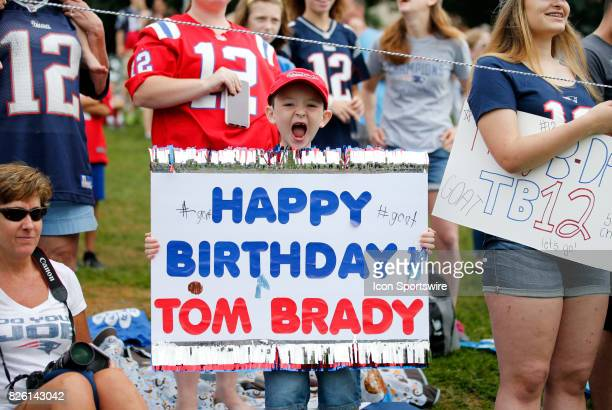A young fan with a message for New England Patriots quarterback Tom Brady on his 40th birthday during Patriots training camp on August 3 at Gillette...